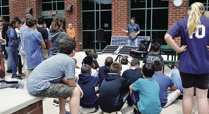 Seth Maughan, director of projects for SolUnesco of Reston, talks to science students at Locust Grove Middle School about solar energy.