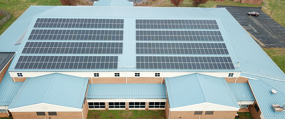 Solar panels on roof of OCHS Hornet Athletic Center.