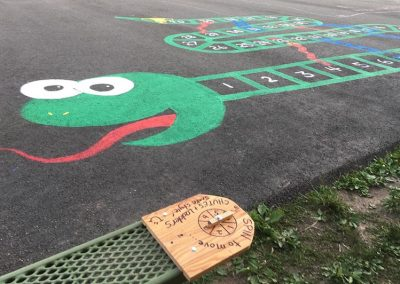 Locust Grove Primary Art Students Turn Blacktop into Fun Game Zone