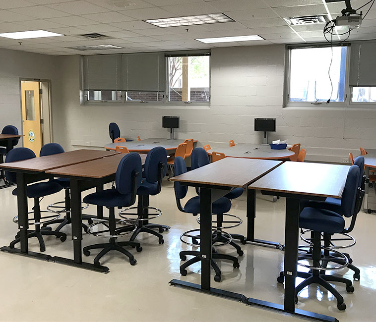 New furniture and projection system installed in the room in Orange County High School which is now occupied by Hornet Technologies.