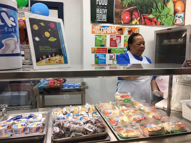 Ms. Conway serves up Green Eggs & Ham for Dr. Seuss Birthday Celebration kick-off to National School Breakfast Week.