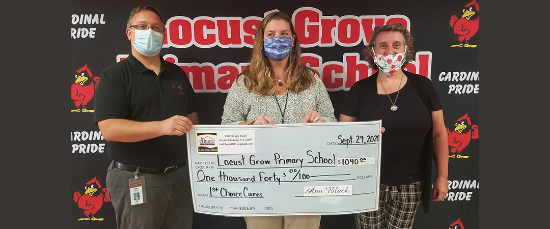 LGPS principal, Lee Finger, LGPS Reading Specialist, Amy Umberger with a donation in the amount of $1040 to the LGPS Reading Program from LeAnn Black of 1st Choice Better Homes & Land.