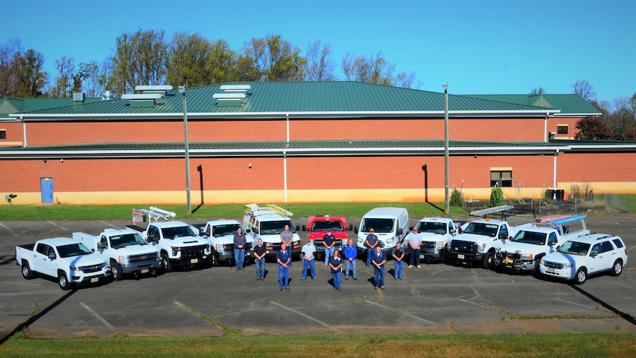 Maintenance Team in front of vehicles