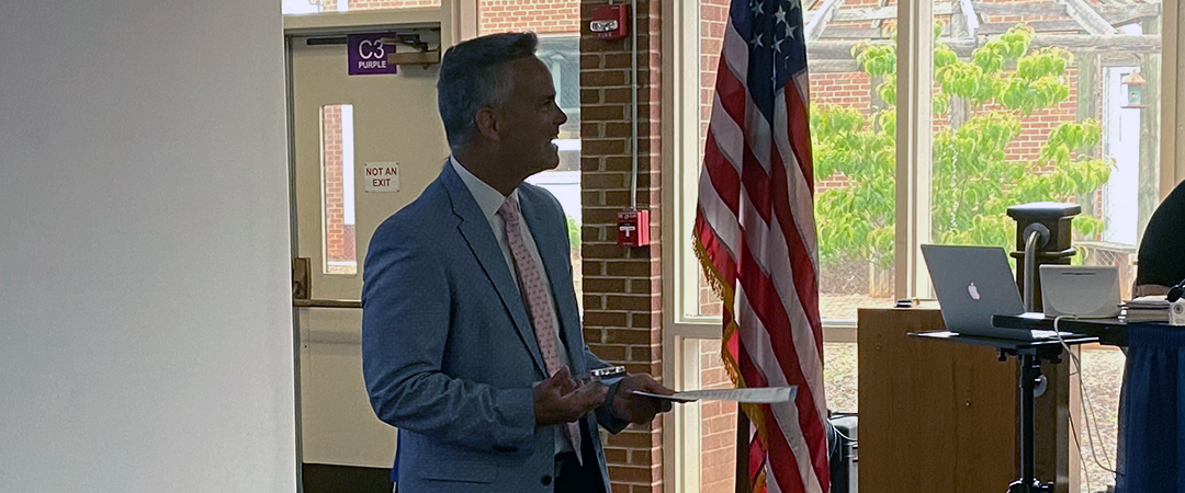 Superintendent Dr. Cecil Snead in front of School Board